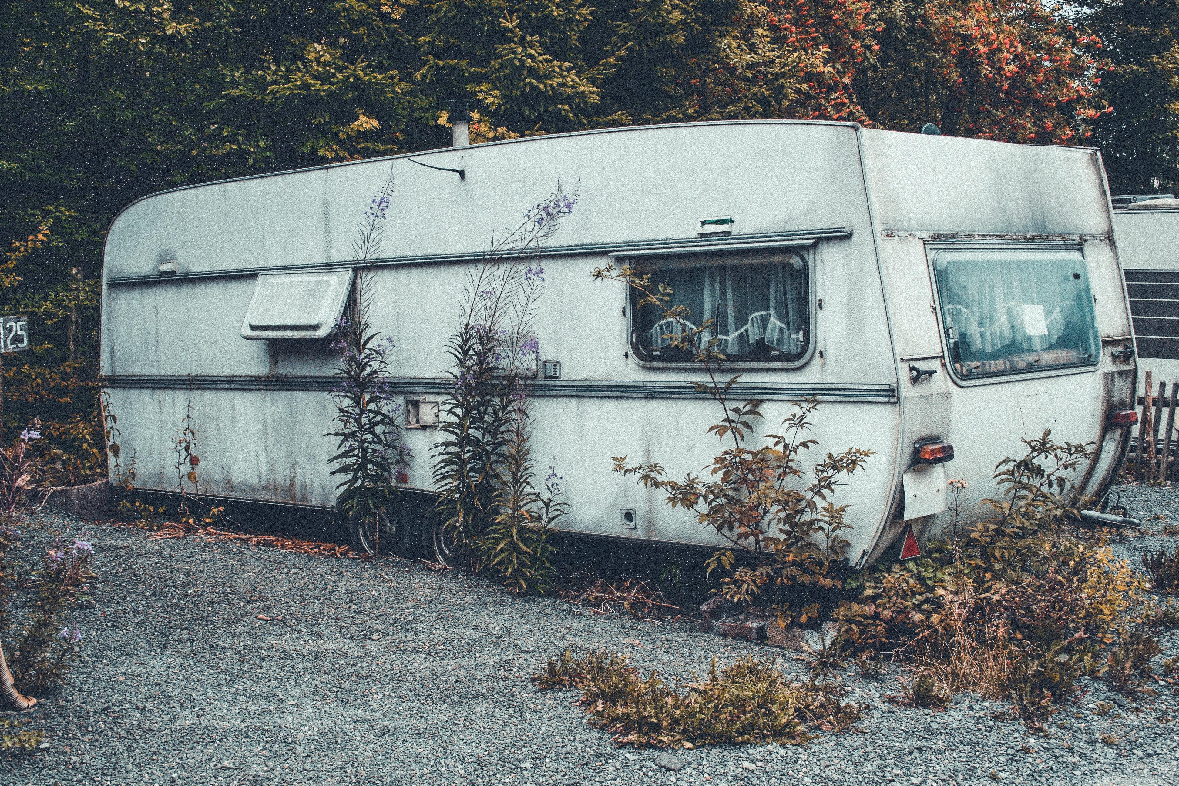This is a photo of an old, run down caravan.
