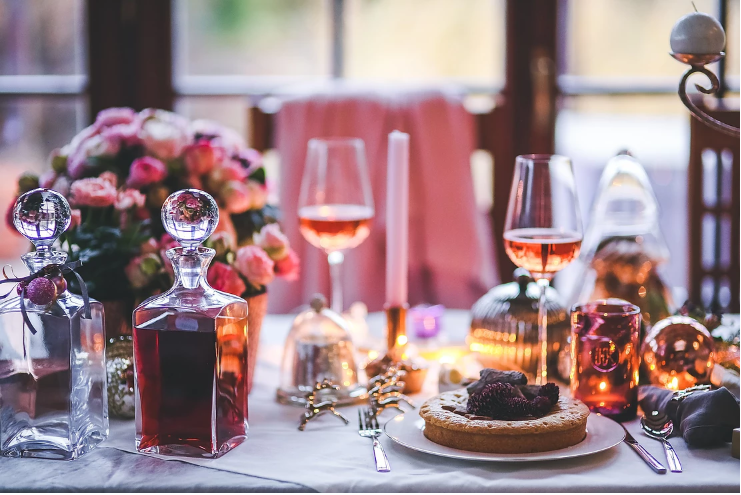 An enticing table, with glasses, food and wine