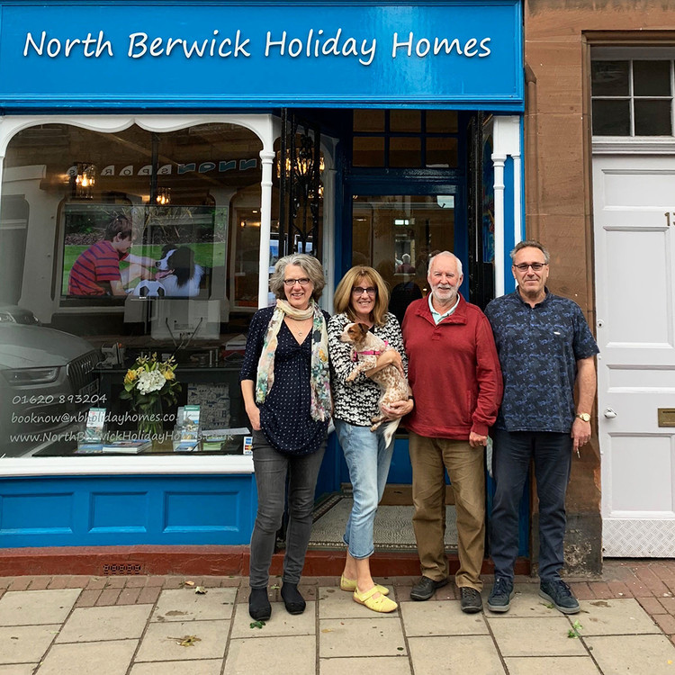 group photos of a family outside north berwick holiday homes