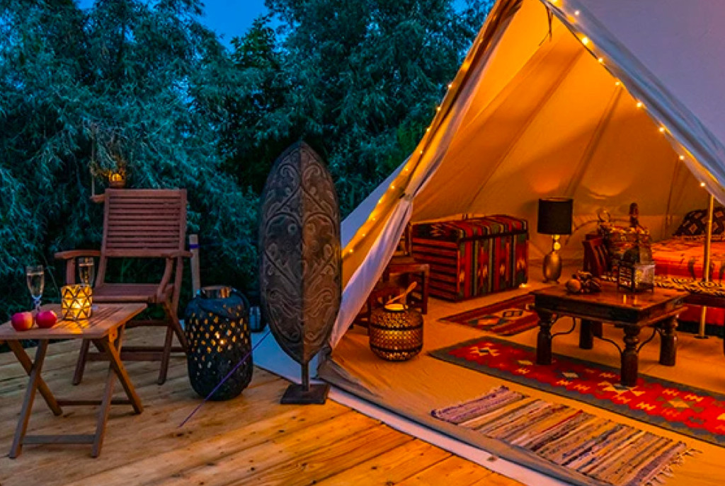 Glamping tent in the forest at night