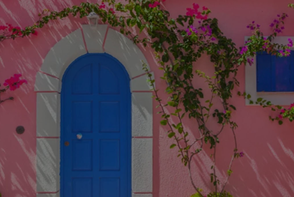 Pink house with blue door and windows