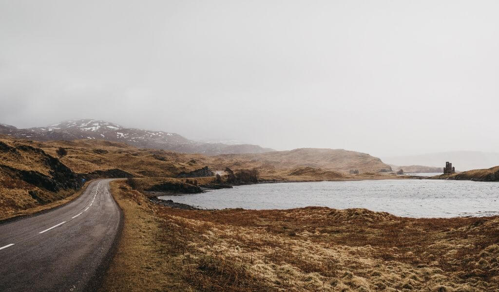 Road going through the Scottish Highlands near Lochinver