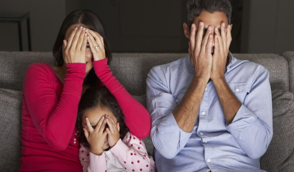 Scared family watching a movie